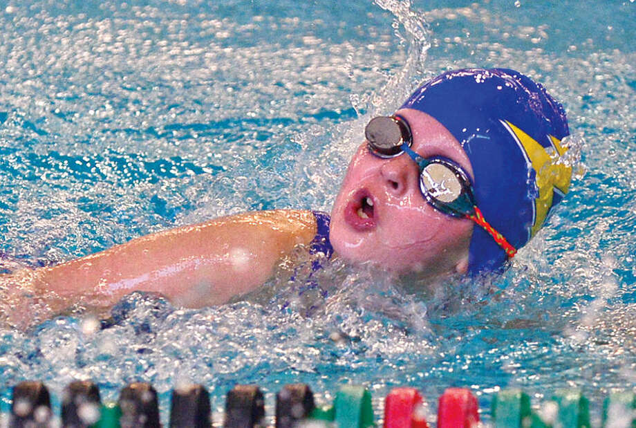 Hour photo / Erik Trautmann Zeus swimmer Rory Keller swims the first leg of the 200 Freestyle Relay during the 12th annual Pat Spinola Swim Invitational at Norwalk High School Saturday.