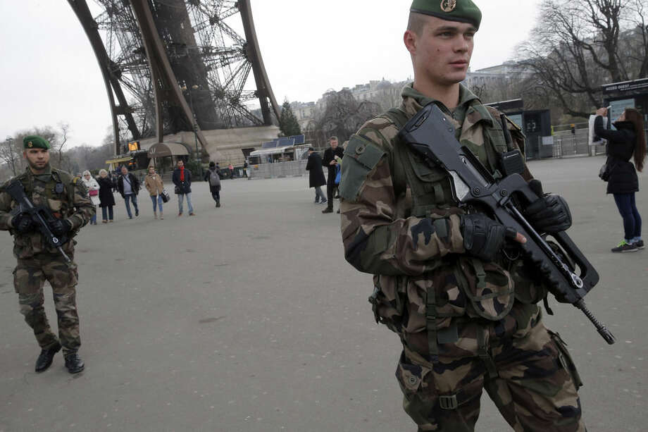 FILE - In this Wednesday Jan. 7, 2015, file photo, French soldiers patrol at the Eiffel Tower after a shooting at a French satirical newspaper in Paris, France. Though it is impossible to gauge in any tangible way the effect the deadly attack on a Paris newspaper will have on recruitment by extremist groups - and there is no evidence so far that it is mobilizing large numbers of would-be jihadis - experts believe the perceived professionalism of the brothers' assault and their subsequent showdown with police could rally more supporters to militant ranks. (AP Photo/Christophe Ena, File)