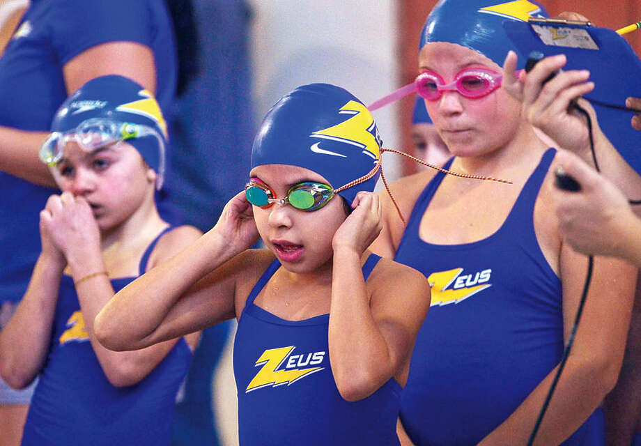 Hour photo / Erik Trautmann Zeus swimmers including Kimberly Velazquezget ready to participate in the 12th annual Pat Spinola Swim Invitational at Norwalk High School Saturday.