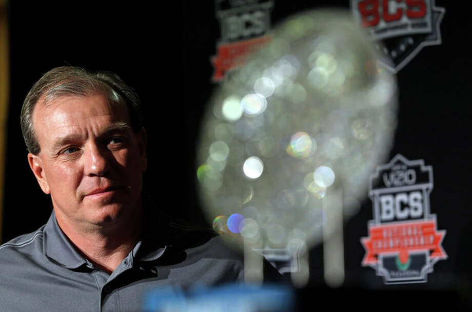 Florida State head coach Jimbo Fisher poses with The Coaches' Trophy during a news conference for the BCS National Championship NCAA college football game Tuesday, Jan. 7, 2014, in Newport Beach, Calif. Florida State beat Auburn 34-31 to win the championship the night before. (AP Photo/David J. Phillip) / AP