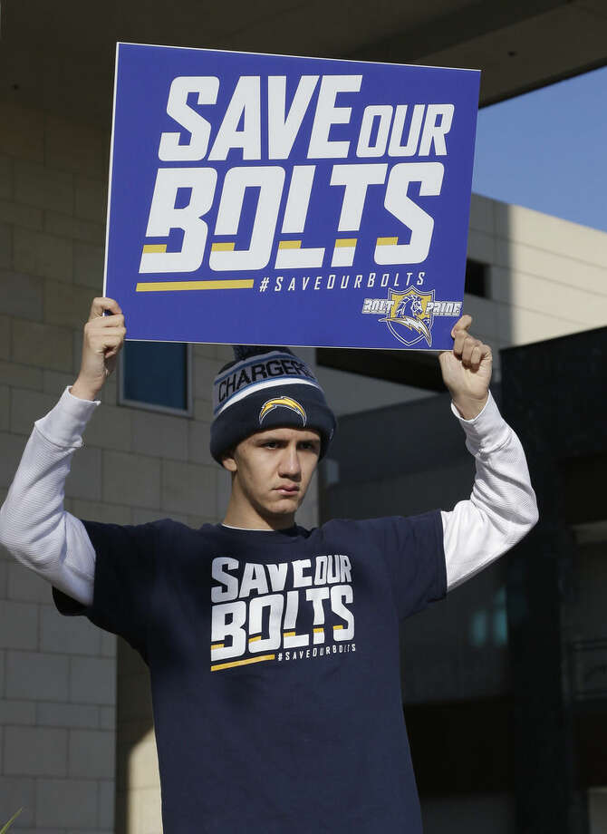 San Diego Chargers fan Richard Farley shows his feelings about keeping the NFL football team in San Diego outside the hotel where NFL owners are meeting Tuesday, Jan. 12, 2016, in Houston to discuss possible relocation to Los Angeles. (AP Photo/Pat Sullivan)