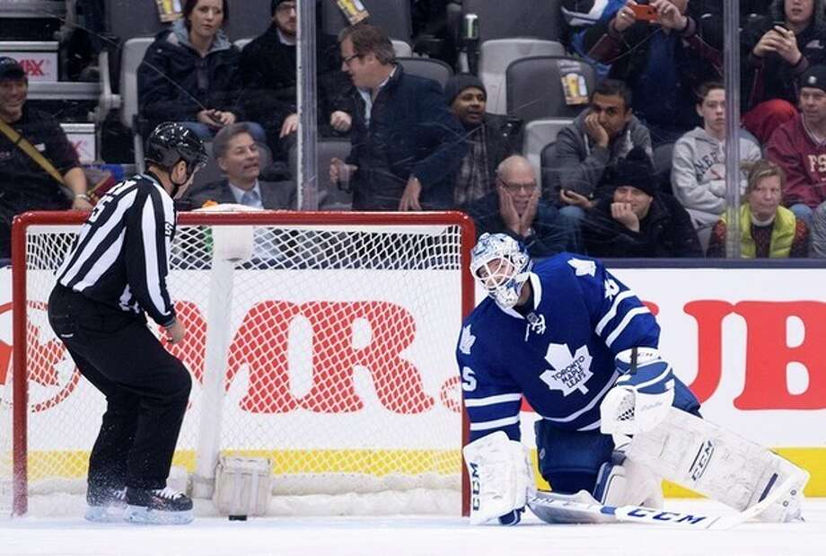 Toronto Maple Leafs goalie Jonathan Bernier reacts after mishandling the puck and allowing a New York Islanders goal during second period of an NHL hockey game in Toronto, Tuesday, Jan. 7, 2014. (AP Photo/The Canadian Press, Nathan Denette) / The Canadian Press