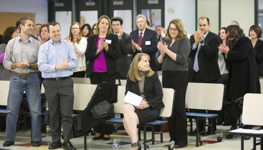 Hour photo/Chris PalermoNew Westport Superintendent Dr. Colleen Palmer receives a standing ovation after being voted in by the Board of Education at Staples High School Monday night.