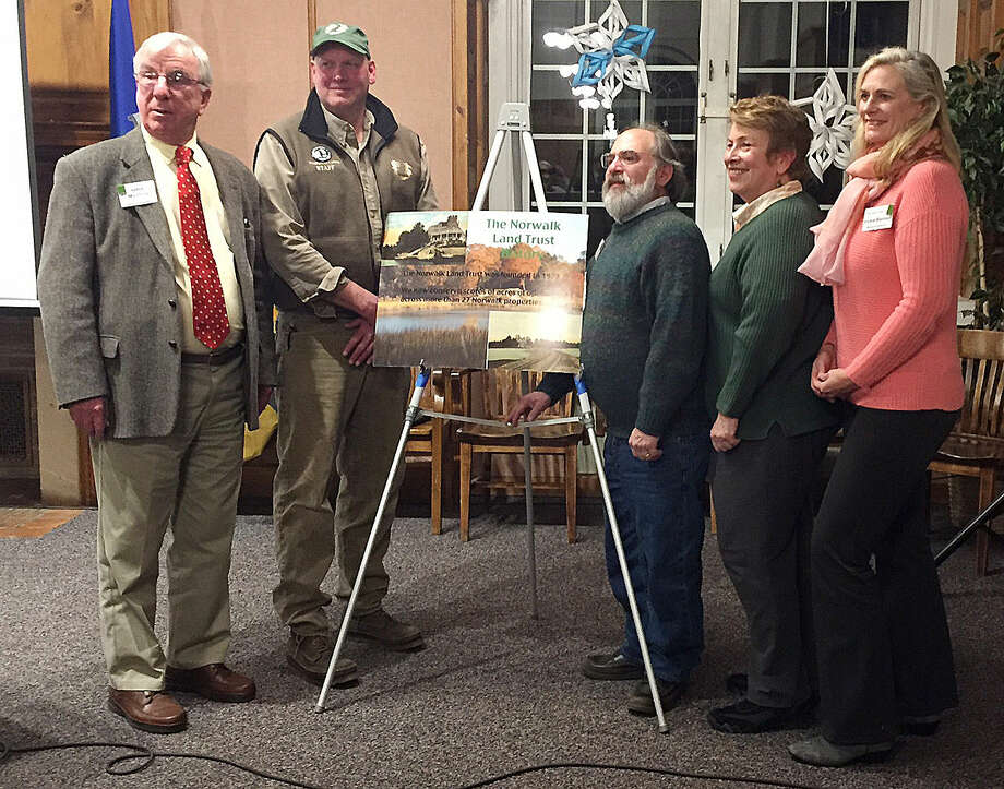 Hour photo/Chris BosakNorwalk Land Trust President John Moeling, Peter Reid of Wildlife in Crisis, and Norwalk land trust members Lee Levy, Midge Kennedy and Vickie Bennett gather at the Norwalk Land Trust's Annual Meeting held Monday at City Hall.