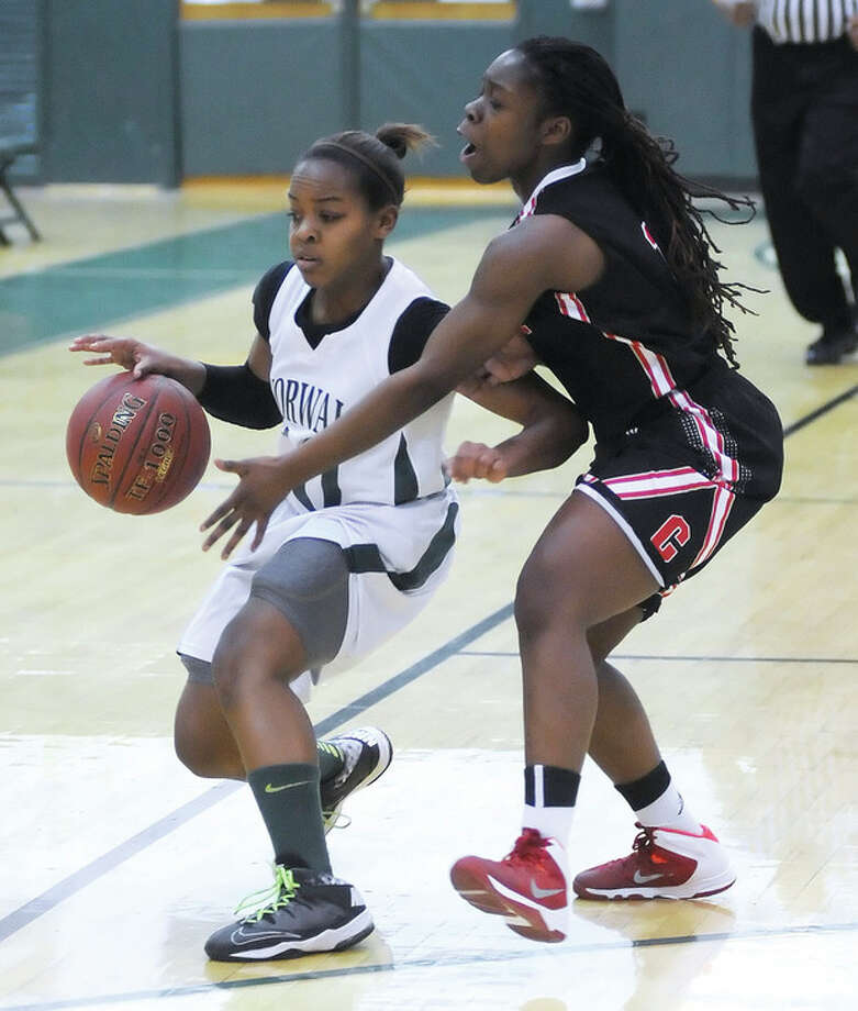 Norwalk's Jackie Harris, left, protects the ball from Bridgeport Central's Diamond Allen as she heads down court during Tuesday's game at Scarso Gym in Norwalk.The Bears defeated Central, 38-28.Hour photo/John Nash