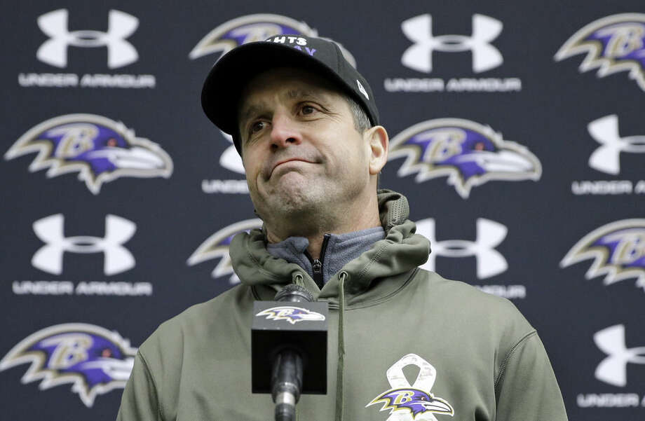 Baltimore Ravens head coach John Harbaugh shrugs his shoulders as he answers a reporter's question at a news conference after an NFL football practice, Thursday, Jan. 8, 2015, in Owings Mills, Md. The Ravens will travel to New England for a divisional playoff game against the Patriots on Saturday, Jan. 10. (AP Photo/Patrick Semansky)