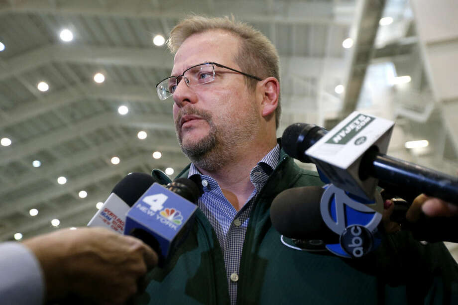 New York Jets general manager Mike Maccagnan speaks to reporters at the team's NFL football training center, Thursday, Jan. 14, 2016, in Florham Park, N.J. (AP Photo/Julio Cortez)
