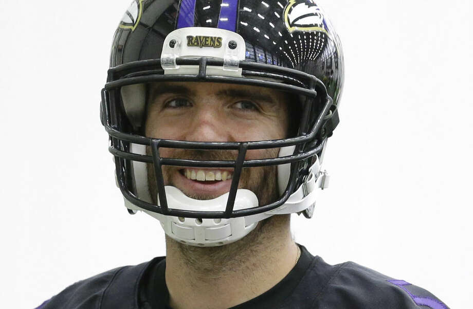 Baltimore Ravens quarterback Joe Flacco walks on the field during an NFL football practice, Wednesday, Jan. 7, 2015, in Owings Mills, Md. The Ravens will travel to New England for a divisional playoff game against the Patriots on Saturday, Jan. 10. (AP Photo/Patrick Semansky)
