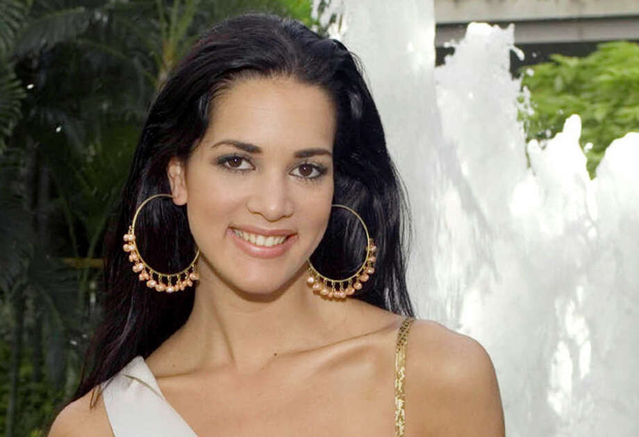 FILE - This May 23, 2005 file photo released by Miss Universe shows Monica Spear, Miss Venezuela 2005, posing for a portrait ahead of the Miss Universe competition in Bangkok, Thailand. Venezuelan authorities say the soap-opera actress and former Miss Venezuela and her husband were shot and killed resisting a robbery after their car broke down. Prosecutors said in a statement that Monica Spear and Henry Thomas Berry were slain late Monday, Jan. 6, 2013 near Puerto Cabello, Venezuela's main port. (AP Photo/Miss Universe Darren Decker, File) / MISS UNIVERSE