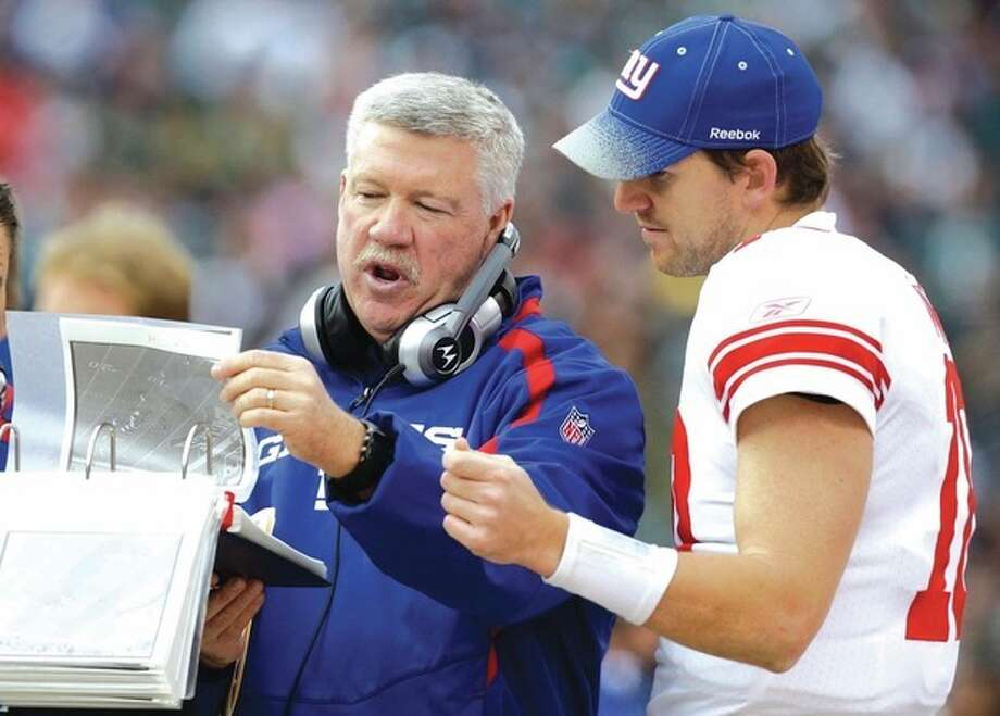 AP photoKevin Gilbride, left, talks to New York Giants quarterback Eli Manning during a November game. Gilbride resigned as the Giants offensive coordinator last week, a move that saddened one of his former college teammates, Frank Moffett of Norwalk. / AP