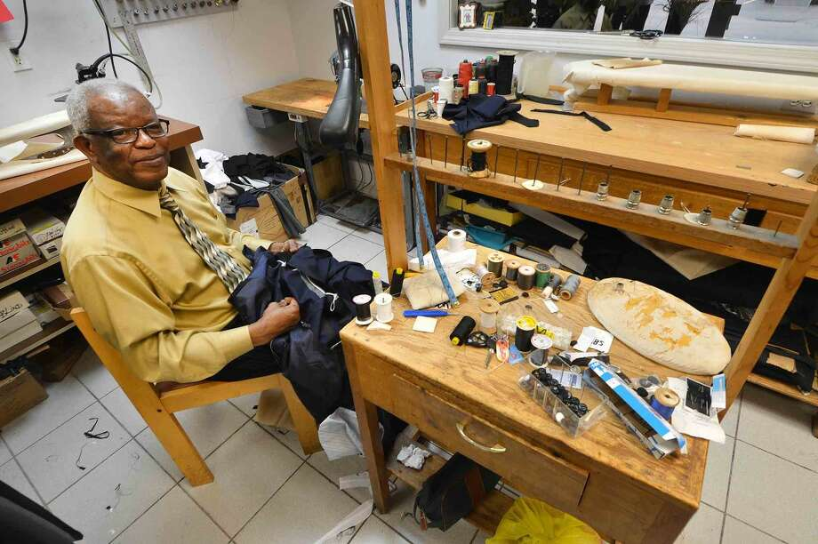 Hour Photo/Alex von Kleydorff Tailor Joseph Alaxis at work at Camillo Tuxedo Specialist in Norwalk