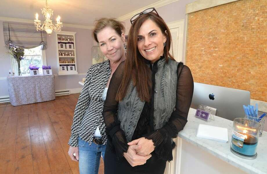 Hour Photo/Alex von Kleydorff Owner Heather Bova and Manager Kelly Daily at the reception area of Ura The Spa in Wilton.