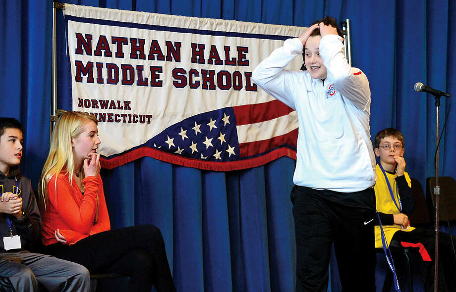 Hour photo / Erik Trautmann Nathan Hale Middle School 8th grader, Nic DiIorio, reacts after competing in the schoolwide Geography Bee Thursday.