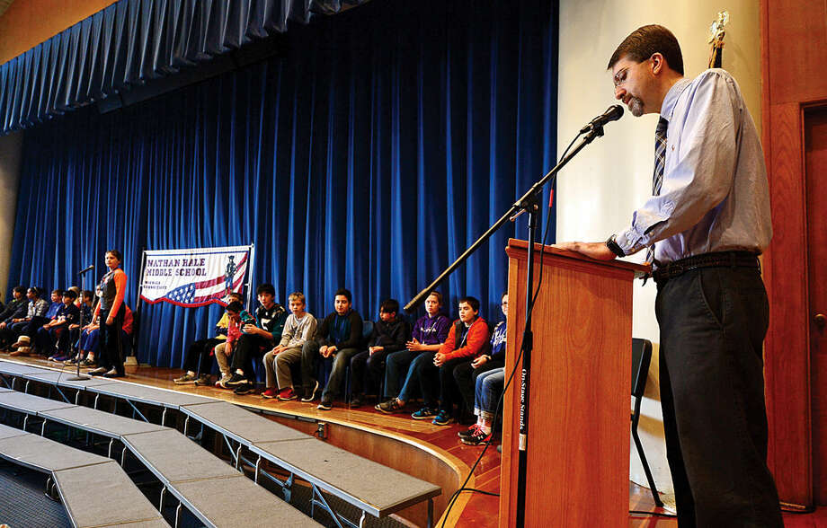 Hour photo / Erik Trautmann Nathan Hale Middle School Social Studies teacher, Dr. David Gibson, leads the quizzing during the schoolwide Geography Bee Thursday.