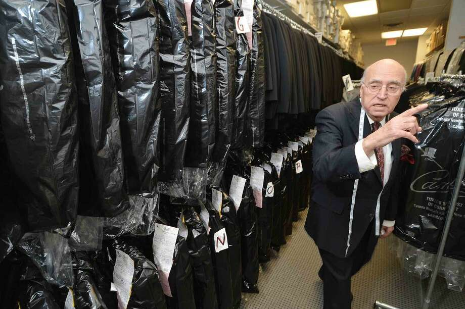 Hour Photo/Alex von Kleydorff Camillo Tramontana in the area where hundreds of tuxedo's wait for pick up by customers at Camillo Tuxedo in Norwalk