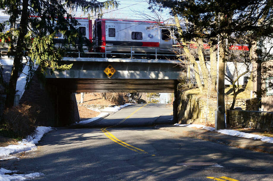 Hour photo / Erik Trautmann The Common Council's Public Works Committee will likely advance a $2.3 million contract to rebuild Rowayton Avenue beneath Metro-North Railroad New Haven Line bridge. Rowayton Avenue is to be lowered and straigthened to provide greater clearance beneath bridge and better sight lines approaching bridge.