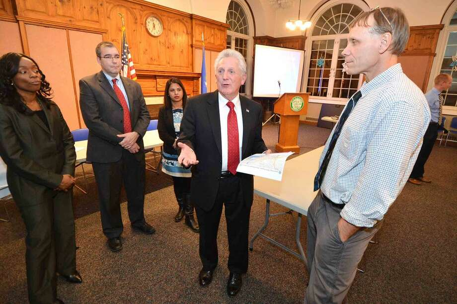 Hour Photo/Alex von Kleydorff Norwalk Mayor Harry Rilling talks with Andy Fesenmeyer, P.E. Project Manager, Division of Highway Design with ConnDOT and other members of the panel during a Public Informational meeting at City Hall about construction projects along !95 in Norwalk and Westport