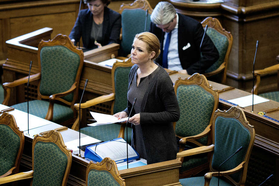 In this Wednesday Jan. 13. 2016 photo, Denmark's immigration minister Inger Stoejberg, speaks in the Danish Parliament during the reading of a new bill on the tightening of family reunification and a tightening of the rules of residence. Hoping to diminish Denmark's appeal to migrants, the country's government plans to force asylum-seekers to hand over any valuables worth more than $1,500 to help cover their housing and food costs while their cases are being processed. (Lars Just/Polfoto via AP) DENMARK OUT