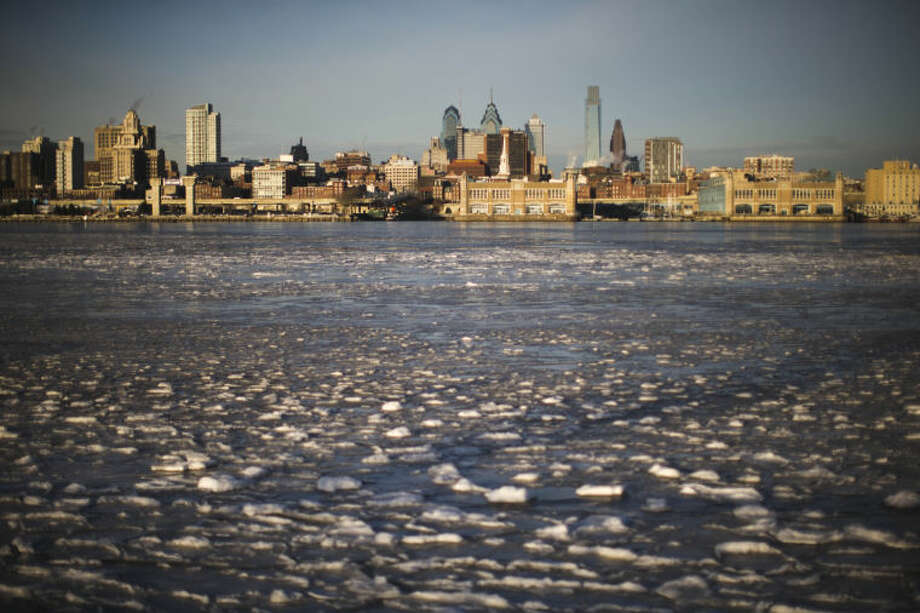 Ice collects on the Delaware River in view of Philadelphia, Wednesday, Jan. 8, 2014. Temperatures across Pennsylvania remain well below freezing but are rising nonetheless after a blast of arctic air set cold-weather records Wednesday, especially in Pittsburgh and elsewhere in western Pennsylvania. (AP Photo/Matt Rourke)