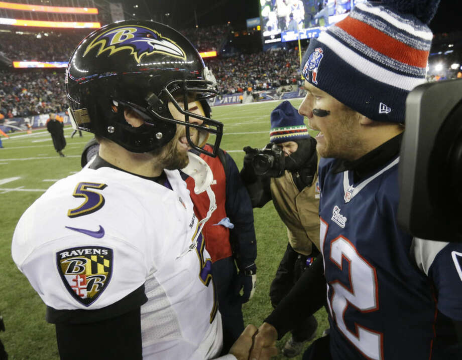 Baltimore Ravens quarterback Joe Flacco (5) and New England Patriots quarterback Tom Brady (12) after an NFL divisional playoff football game Saturday, Jan. 10, 2015, in Foxborough, Mass. The Patriots won 35-31 to advance to the AFC Championship game. (AP Photo/Steven Senne)