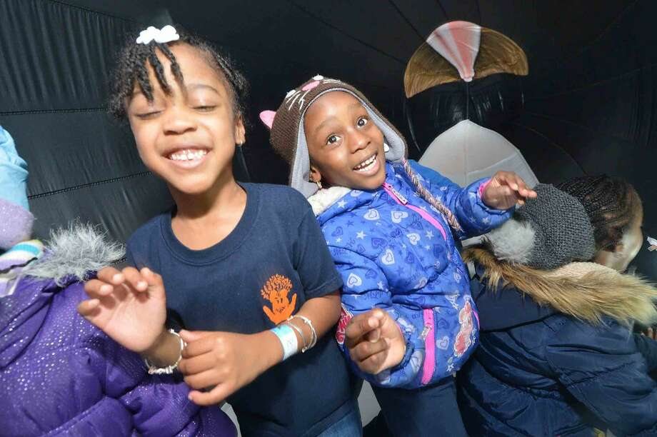 Hour Photo/Alex von Kleydorff 5yr olds Lekia Nwiido and Royce Daniels with The Garvey School explore the inside of a lifesize inflatable Humpback Whale, part of a new exhibit at The Maritime Aquarium