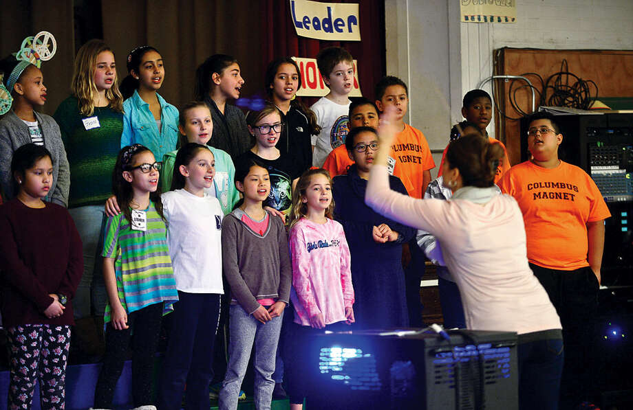 Hour photo / Erik Trautmann The 4th and 5th grade chorus sing during the Columbus Magnet School annual All School Meeting Peace Games assembly that honors the work and memory of Dr. Martin Luther King, Jr.