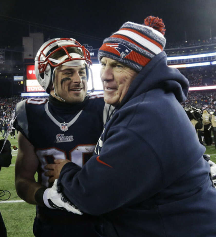New England Patriots head coach Bill Belichick celebrates with wide receiver Danny Amendola (80) after an NFL divisional playoff football game against the Baltimore Ravens Saturday, Jan. 10, 2015, in Foxborough, Mass. The Patriots won 35-31 to advance to the AFC Championship game. (AP Photo/Steven Senne)