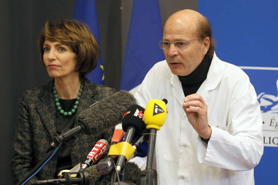French Health Minister Marisol Touraine, left, and Professor Gilles Edan, the chief neuroscientist at Rennes Hospital, address the media during a press conference held in Rennes, western France, Friday, Jan. 15, 2016. Six previously healthy medical volunteers have been hospitalized — including one man who is now brain dead — after taking part in a botched drug test at the Biotrial lab in western France, the French Health Ministry said Friday. (AP Photo/David Vincent)
