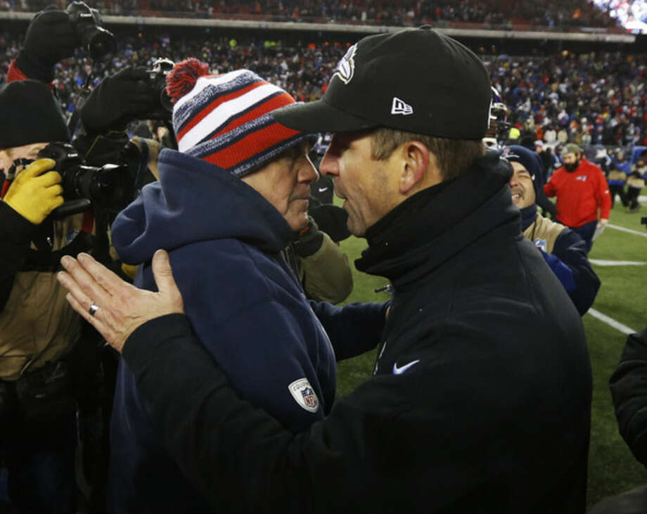 New England Patriots head coach Bill Belichick, left, and Baltimore Ravens head coach John Harbaugh after an NFL divisional playoff football game Saturday, Jan. 10, 2015, in Foxborough, Mass. The Patriots won 35-31 to advance to the AFC Championship game. (AP Photo/Elise Amendola)