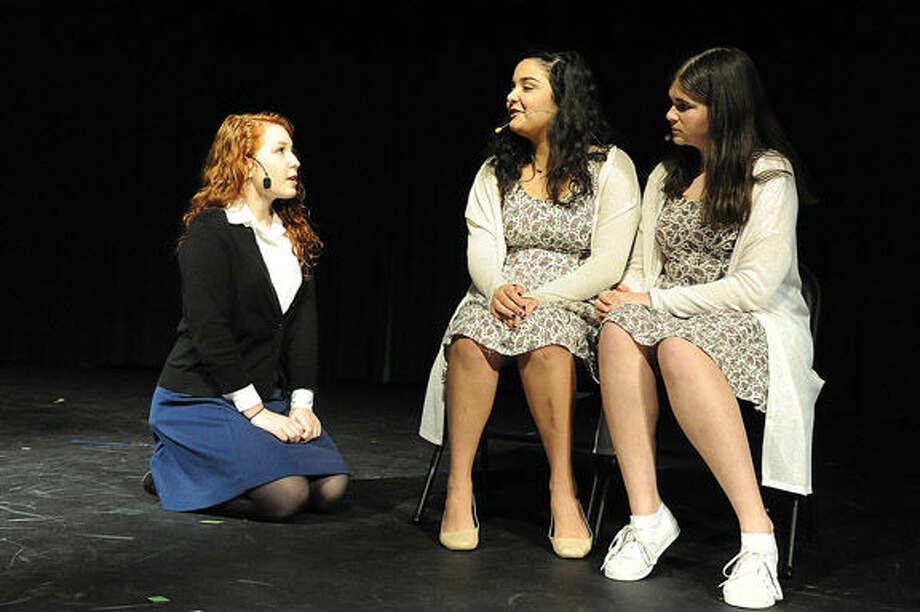 "Emma Rogers as Melissa Weiss, Cathy Colmenares as Casey Wallace and Sabrina Rollings as Riley Wallace in a dress rehearsal for the play ""Keychain"" that was written and produced by 15 year old Zachary Anderson of Norwalk High School. Hour photo/Matthew Vinci"