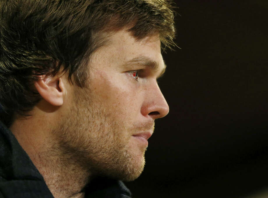 New England Patriots quarterback Tom Brady speaks outside the locker room after an NFL divisional playoff football game against the New England Patriots Saturday, Jan. 10, 2015, in Foxborough, Mass. The Patriots won 35-31 to advance to the AFC Championship game. (AP Photo/Elise Amendola)