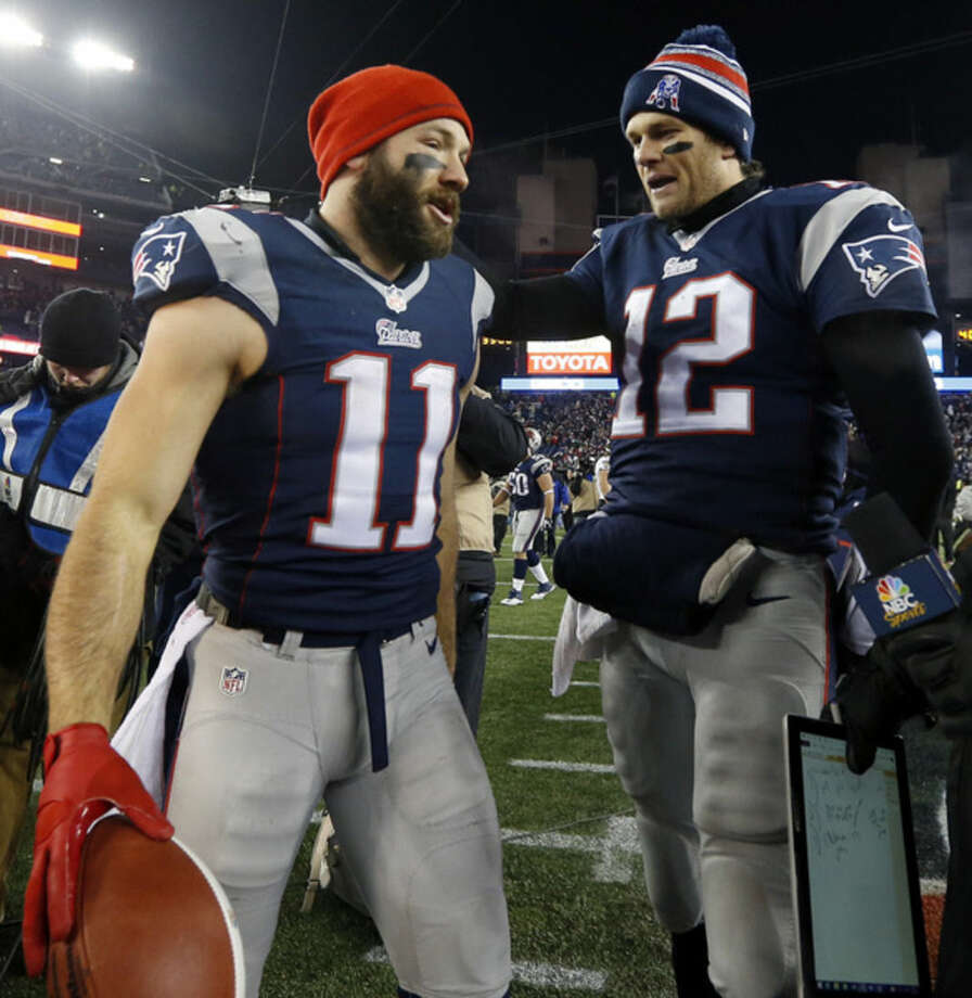 New England Patriots wide receiver Julian, left, and quarterback Tom Brady speak after an NFL divisional playoff football game against the Baltimore Ravens Saturday, Jan. 10, 2015, in Foxborough, Mass. The Patriots won 35-31 to advance to the AFC Championship game. (AP Photo/Elise Amendola)