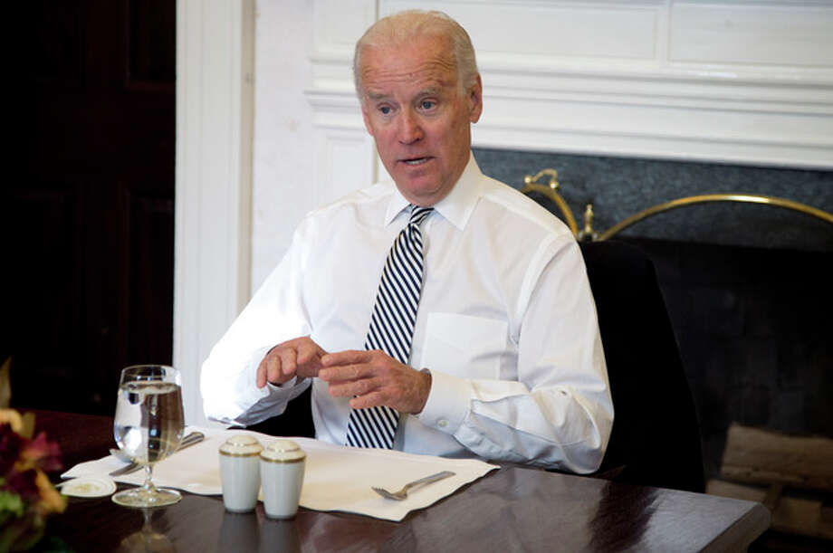 Vice President Joe Biden gestures as he speaks during a photo-op as he meets with President Barack Obama for lunch in the Private Dining Room of the White House in Washington, Wednesday, Jan. 8, 2014. (AP Photo/Carolyn Kaster) / AP