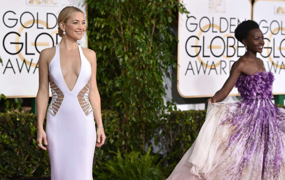 Kate Hudson, left, and Lupita Nyong'o arrive at the 72nd annual Golden Globe Awards at the Beverly Hilton Hotel on Sunday, Jan. 11, 2015, in Beverly Hills, Calif. (Photo by John Shearer/Invision/AP)