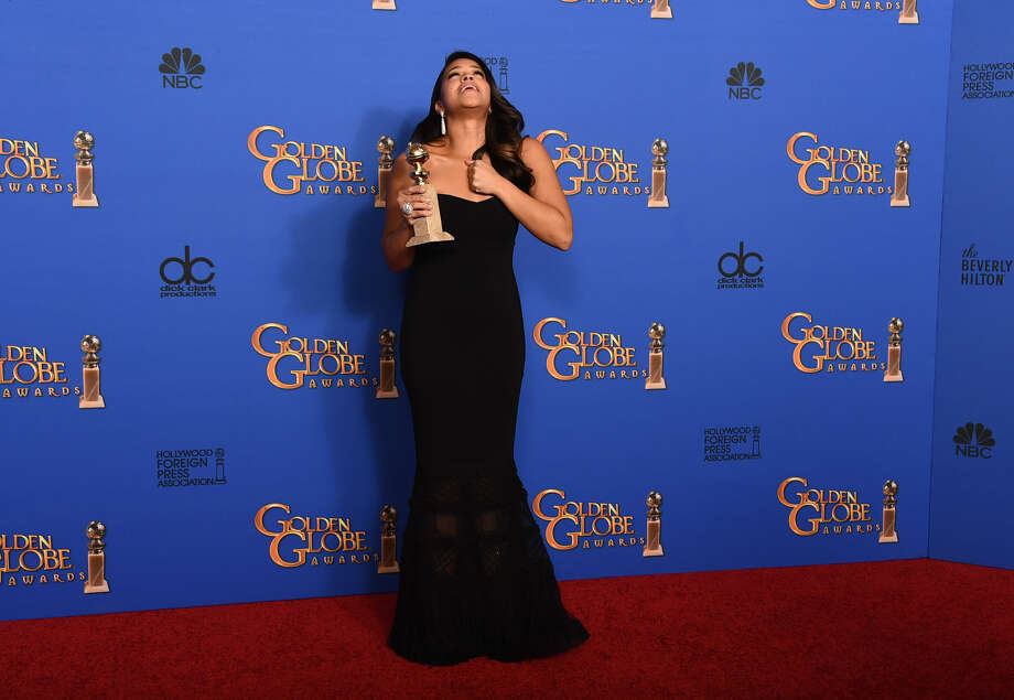 "Gina Rodriguez poses in the press room with the award for best actress in a television series - musical or comedy for ""Jane the Virgin"" at the 72nd annual Golden Globe Awards at the Beverly Hilton Hotel on Sunday, Jan. 11, 2015, in Beverly Hills, Calif. (Photo by Jordan Strauss/Invision/AP)"