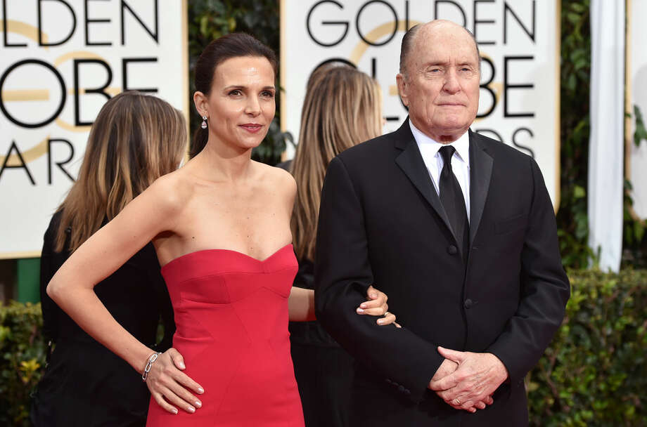 Luciana Duvall, left, and Robert Duvall arrive at the 72nd annual Golden Globe Awards at the Beverly Hilton Hotel on Sunday, Jan. 11, 2015, in Beverly Hills, Calif. (Photo by John Shearer/Invision/AP)