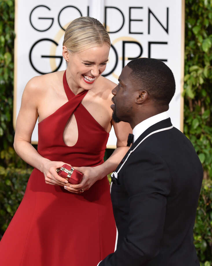 Taylor Schilling, left, and Kevin Hart arrive at the 72nd annual Golden Globe Awards at the Beverly Hilton Hotel on Sunday, Jan. 11, 2015, in Beverly Hills, Calif. (Photo by John Shearer/Invision/AP)