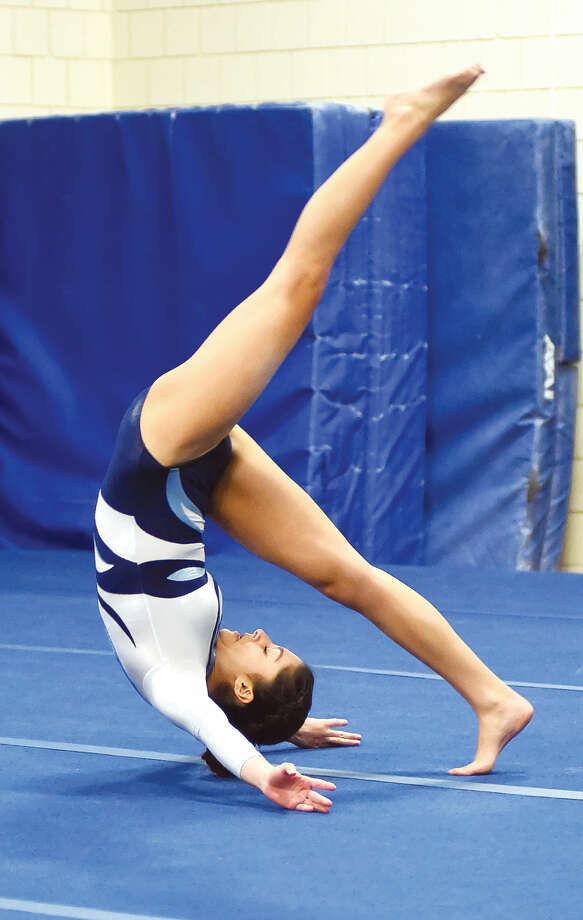 Wilton's Alex Uriarte performs on the floor exercise during Thursday's dual meet against Staples.