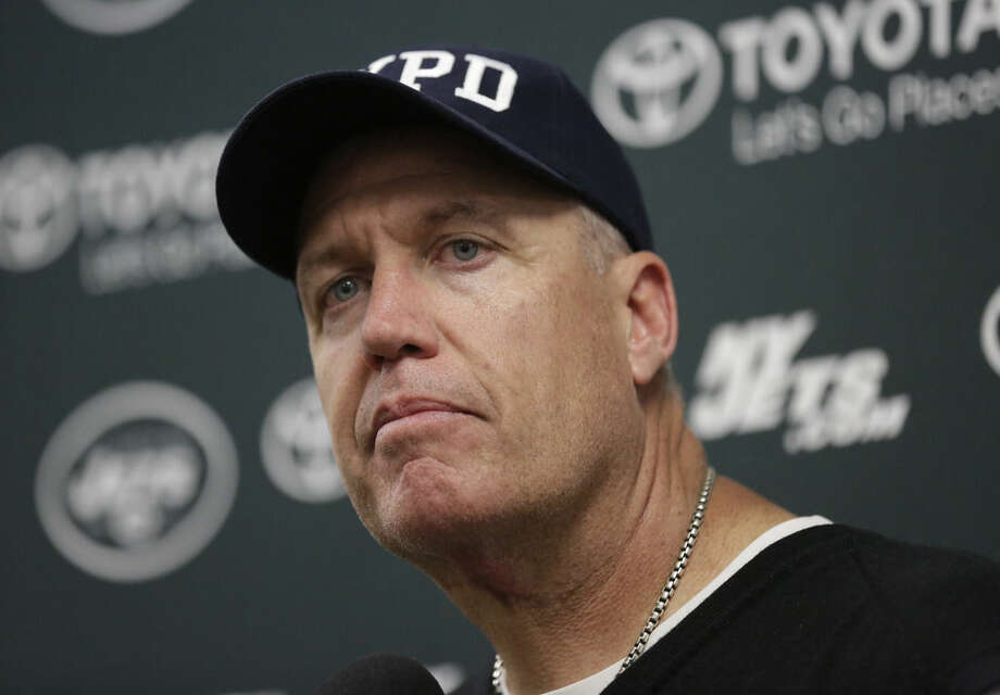 FILE - In a Sunday, Dec. 28, 2014 file photo, New York Jets head coach Rex Ryan listens to a questions during a news conference following an NFL football game against the Miami Dolphins, in Miami Gardens, Fla. The Buffalo Bills has offered the head coaching job to the former New York Jets coach, and the sides are negotiating final contract details, a person familiar with the talks told The Associated Press on Sunday, Jan. 11, 2015. (AP Photo/Lynne Sladky, File)