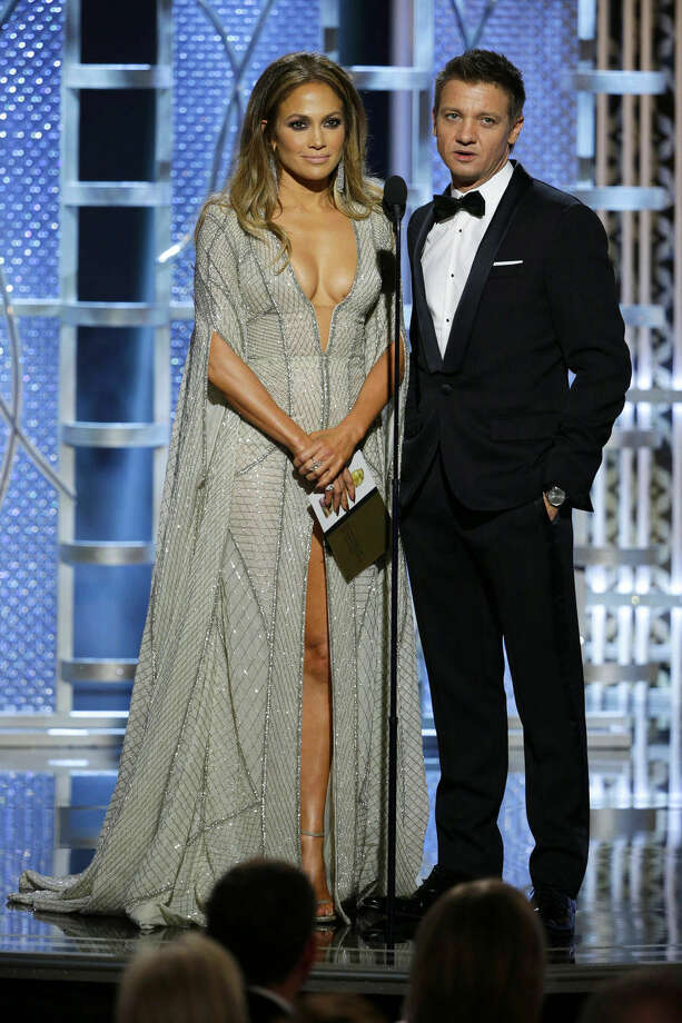 In this image released by NBC, Jennifer Lopez, left, and Jeremy Renner present an award at the 72nd Annual Golden Globe Awards on Sunday, Jan. 11, 2015, at the Beverly Hilton Hotel in Beverly Hills, Calif. (AP Photo/NBC, Paul Drinkwater)