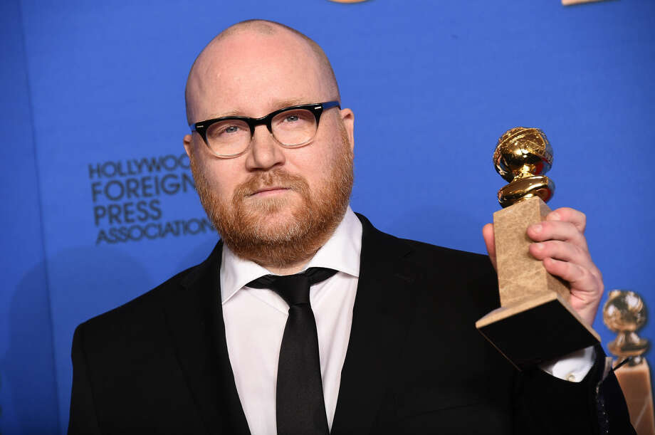 "Johann Johannsson poses in the press room with the award for best original score for ""The Theory of Everything"" at the 72nd annual Golden Globe Awards at the Beverly Hilton Hotel on Sunday, Jan. 11, 2015, in Beverly Hills, Calif. (Photo by Jordan Strauss/Invision/AP)"