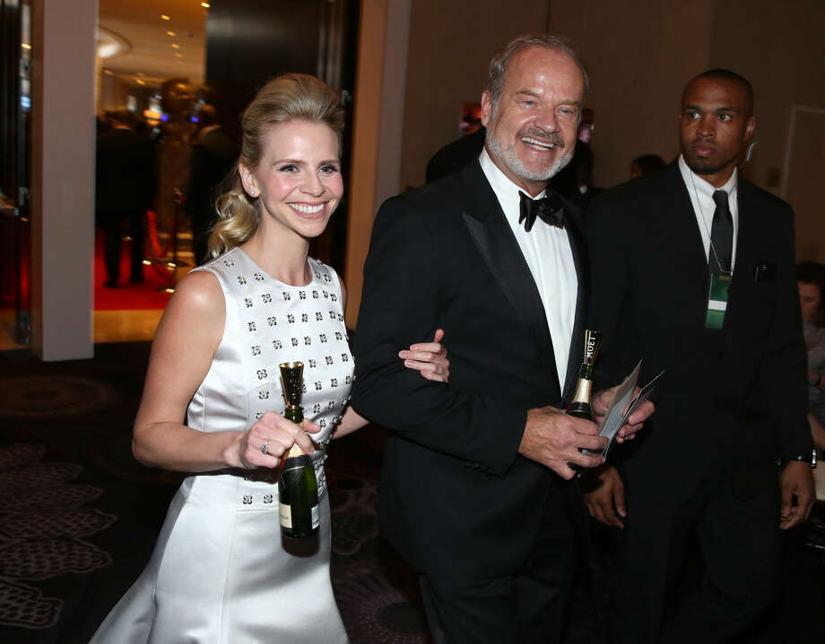 Kayte Walsh, left, and Kelsey Grammer walk in the audience at the 72nd annual Golden Globe Awards at the Beverly Hilton Hotel on Sunday, Jan. 11, 2015, in Beverly Hills, Calif. (Photo by Matt Sayles/Invision/AP)