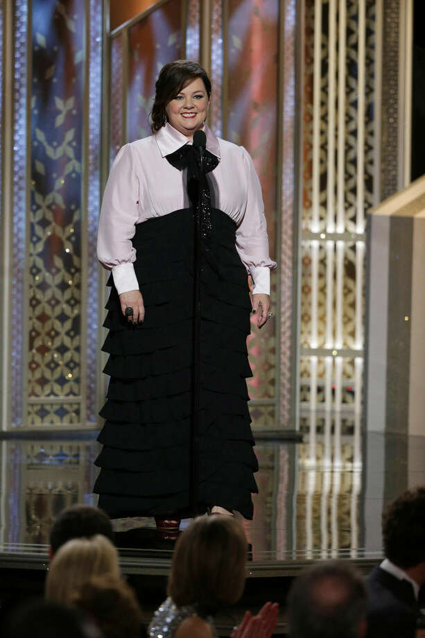 In this image released by NBC, Melissa McCarthy speaks at the 72nd Annual Golden Globe Awards on Sunday, Jan. 11, 2015, at the Beverly Hilton Hotel in Beverly Hills, Calif. (AP Photo/NBC, Paul Drinkwater)