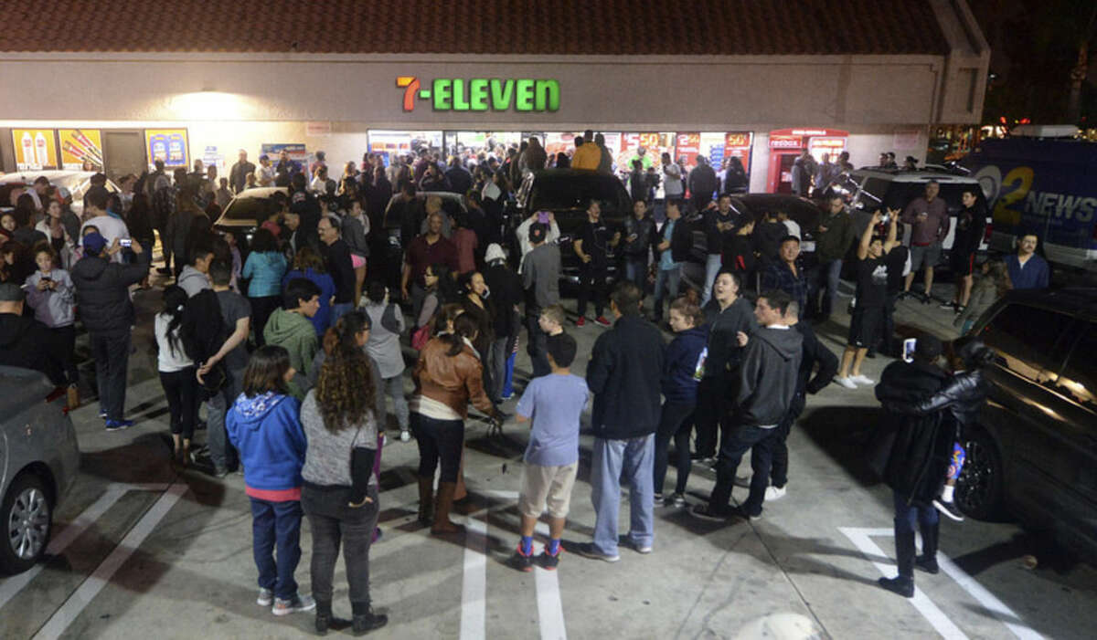 Hundreds gather outside the 7-Eleven, after it was announced the winning Powerball ticket was sold at the store, Wednesday, Jan. 13, 2016 in Chino Hills, Calif. One winning ticket was sold at the store located in suburban Los Angeles said Alex Traverso, a spokesman for California lottery. The identity of the winner is not yet known. (Will Lester/The Sun via AP) MANDATORY CREDIT