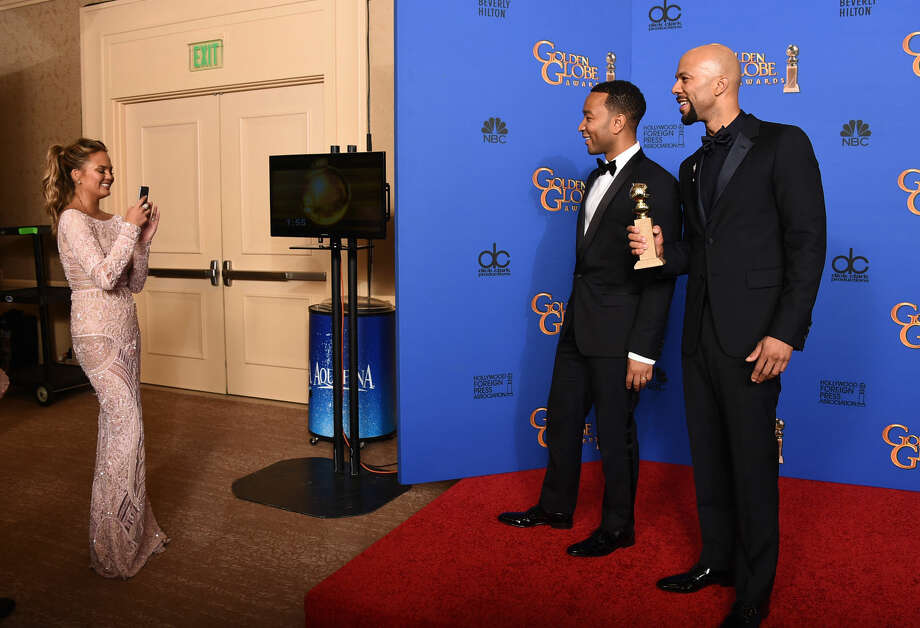 "Chrissy Teigen, from left, John Legend and Common pose in the press room with the award for best original song ""Glory"" in a film for ""Selma"" at the 72nd annual Golden Globe Awards at the Beverly Hilton Hotel on Sunday, Jan. 11, 2015, in Beverly Hills, Calif. (Photo by Jordan Strauss/Invision/AP)"