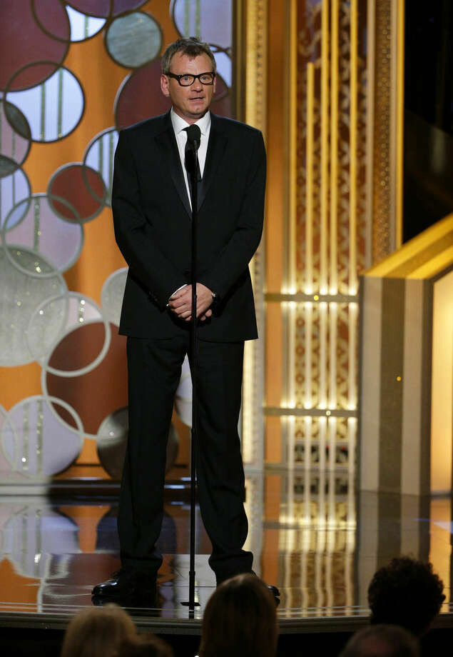 In this image released by NBC, Theo Kingma, President of the Hollywood Foreign Press Association, speaks at the 72nd Annual Golden Globe Awards on Sunday, Jan. 11, 2015, at the Beverly Hilton Hotel in Beverly Hills, Calif. (AP Photo/NBC, Paul Drinkwater)