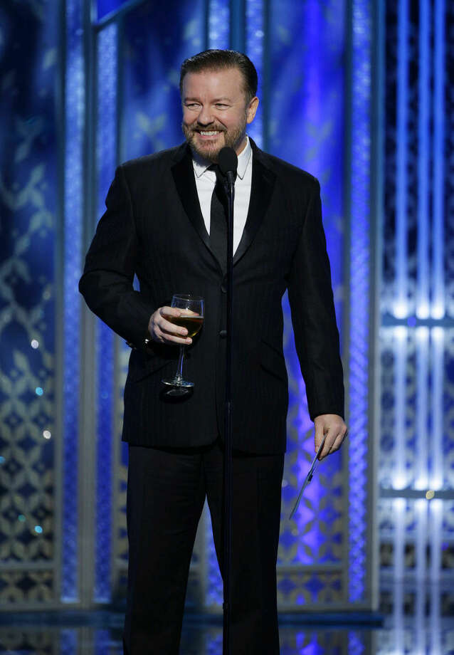 In this image released by NBC, Ricky Gervais speaks at the 72nd Annual Golden Globe Awards on Sunday, Jan. 11, 2015, at the Beverly Hilton Hotel in Beverly Hills, Calif. (AP Photo/NBC, Paul Drinkwater)