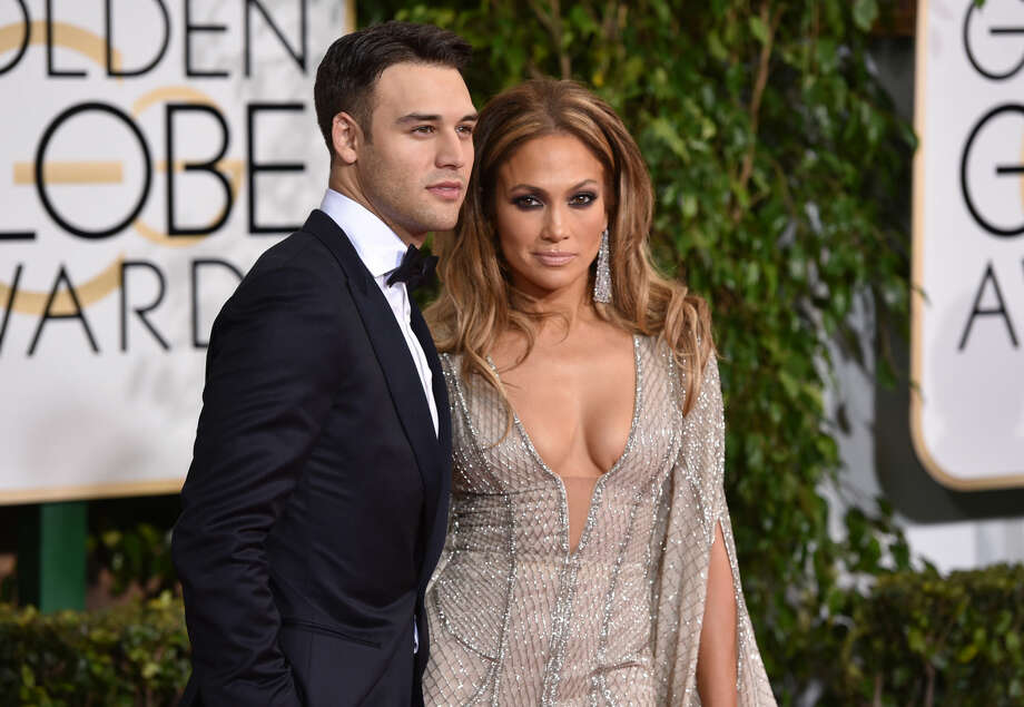 Ryan Guzman, left, and Jennifer Lopez arrive at the 72nd annual Golden Globe Awards at the Beverly Hilton Hotel on Sunday, Jan. 11, 2015, in Beverly Hills, Calif. (Photo by John Shearer/Invision/AP)