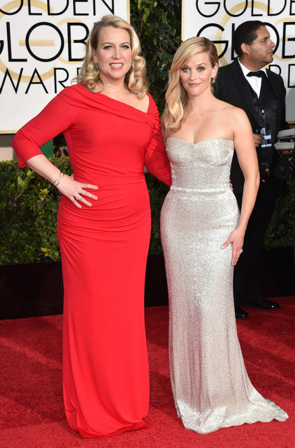 Cheryl Strayed, left, and Reese Witherspoon arrive at the 72nd annual Golden Globe Awards at the Beverly Hilton Hotel on Sunday, Jan. 11, 2015, in Beverly Hills, Calif. (Photo by John Shearer/Invision/AP)
