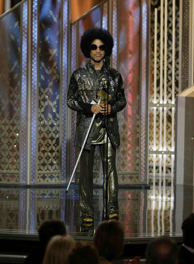 In this image released by NBC, Prince presents an award at the 72nd Annual Golden Globe Awards on Sunday, Jan. 11, 2015, at the Beverly Hilton Hotel in Beverly Hills, Calif. (AP Photo/NBC, Paul Drinkwater)